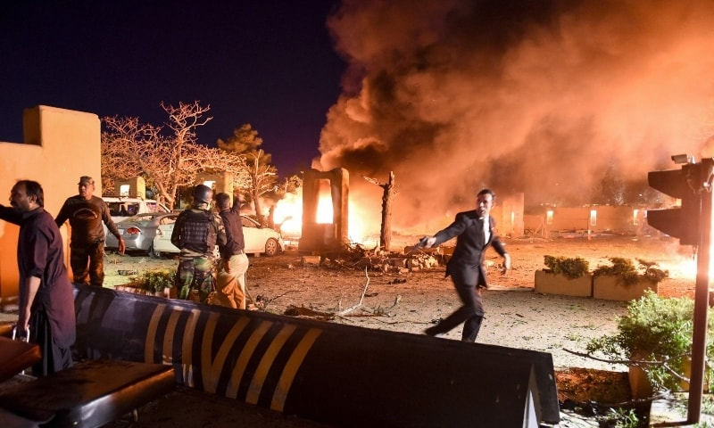 Security personnel and volunteers arrive at the site of an explosion in Quetta on April 21. — AFP