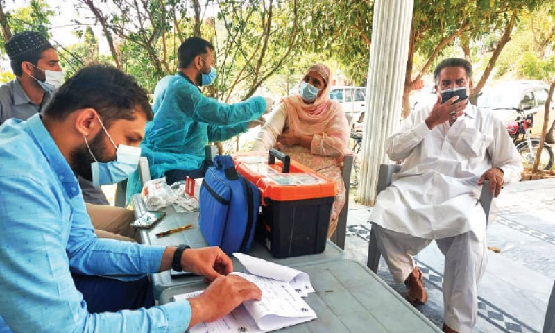 A health worker administers Covid-19 vaccine to a senior citizen at Saidpur Village in Islamabad on Wednesday. — White Star
