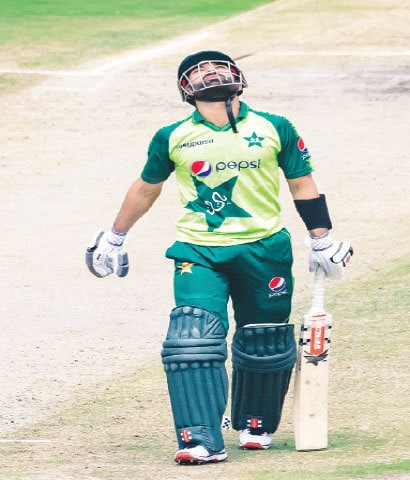 PAKISTAN opener Mohammad Rizwan celebrates after completing his half-century on Wednesday.—AFP