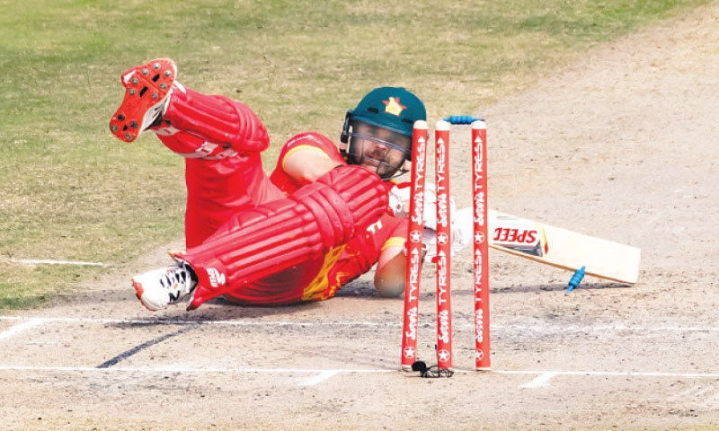 HARARE: Zimbabwe batsman Ryan Burl falls over as he is bowled by Pakistan paceman Haris Rauf during the first Twenty20 International at the Harare Sports Club on Wednesday.—AFP