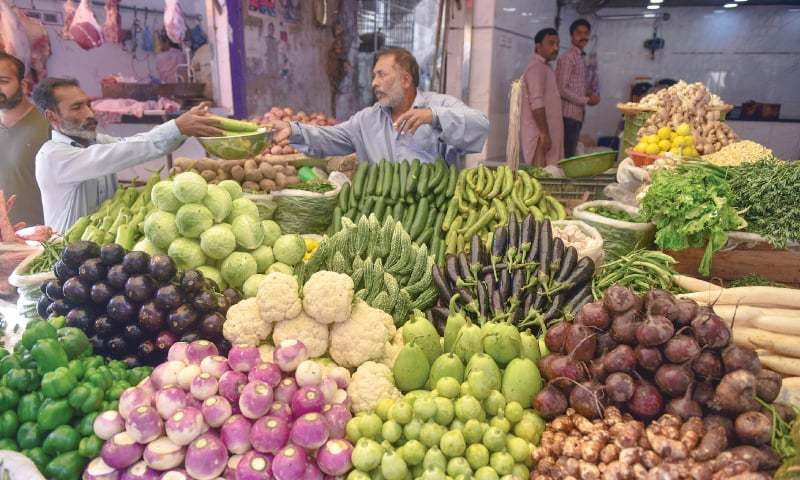 This file photo shows a vendor at Karachi's Burnes Road's vegetable market.—Fahim Siddiqi / White Star
