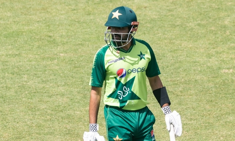 Pakistan's captian Babar Azam walks off the pitch after being dismissed by Zimbabwe's Blessing Muzarabani during the first Twenty20 international cricket match between Zimbabwe and Pakistan at the Harare Sports Club in Harare on April 21. - AFP