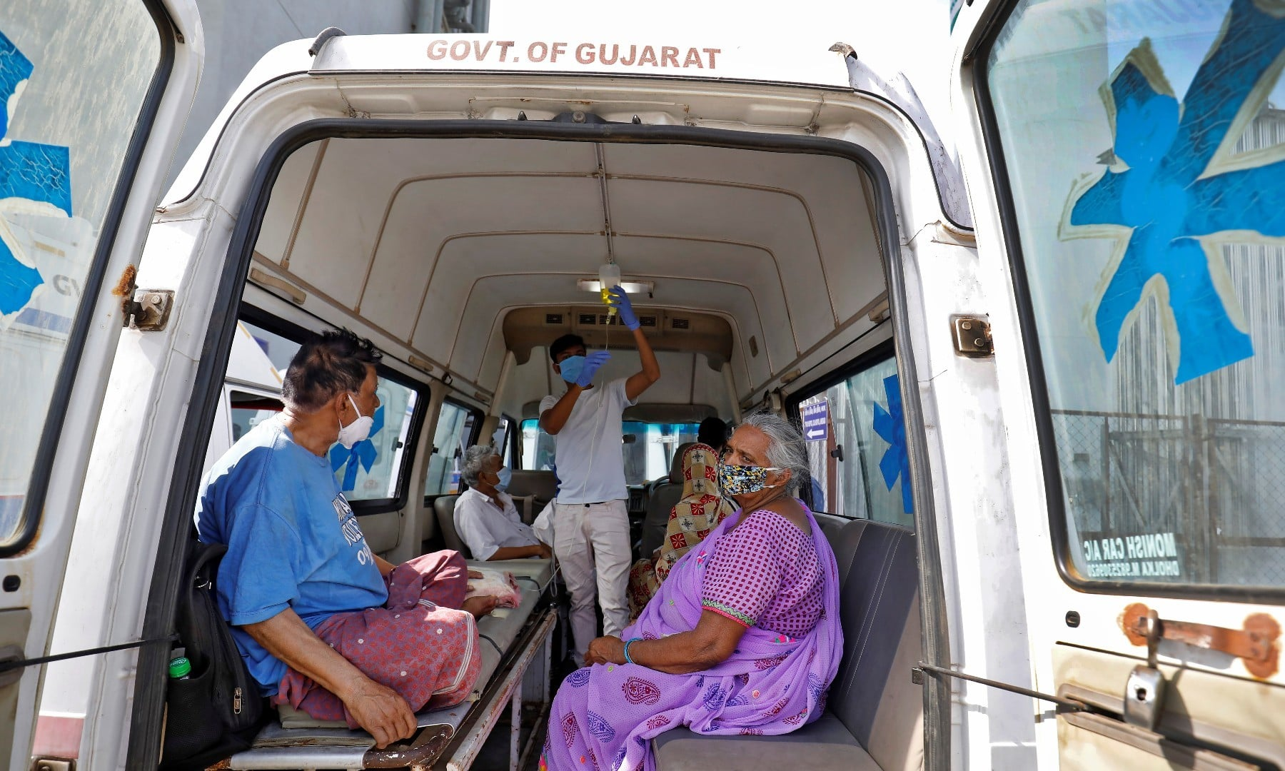 Patients are seen inside an ambulance while waiting to enter a Covid-19 hospital for treatment in Ahmedabad on April 22. — Reuters