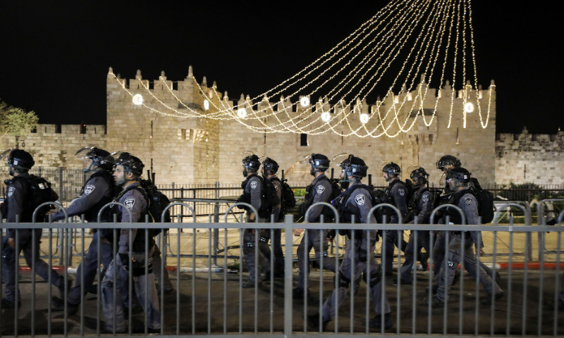 Israeli police officers patrol during clashes with Palestinians near Damascus Gate just outside Jerusalem's Old City during Ramazan. — Reuters