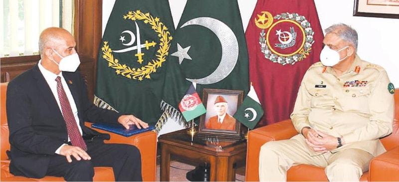 RAWALPINDI: Chief of the Army Staff Gen Qamar Javed Bajwa speaks to Afghan Ambassador Najibullah Ali Khil during a meeting on Thursday.—INP