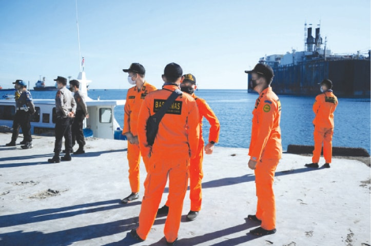 CELUKAN BAWANG: Members of a rescue team prepare for a search operation for the submarine off the coast of Bali.—AFP