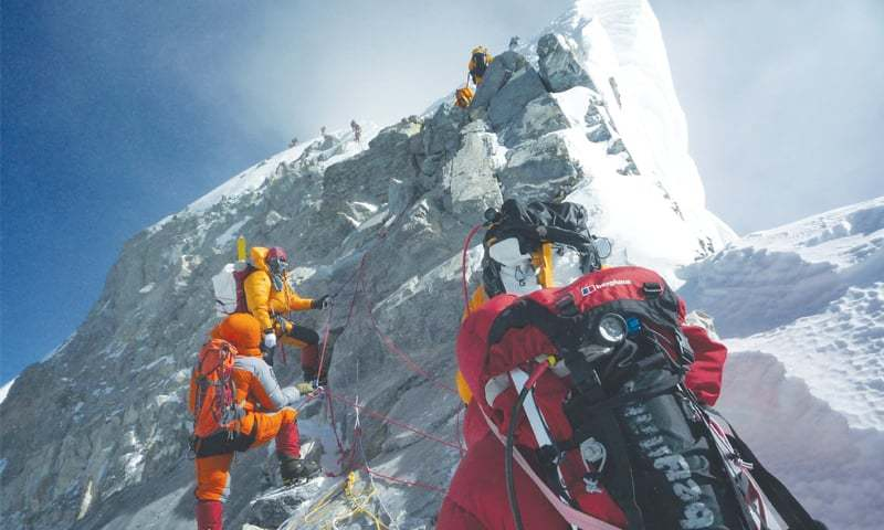 In this file photograph taken on May 19, 2009, mountaineers climb the south face of Mount Everest from Nepal. —AFP/File