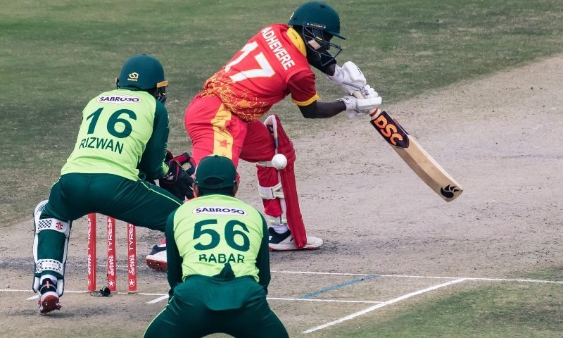 Zimbabwe's Wesley Madhevere (R) plays a shot as Pakistan wicketkeeper Mohammad Rizwan (L) and captain Babar Azam (C) look on during the second Twenty20 international between Zimbabwe and Pakistan at the Harare Sports Club in Harare on April 23. — AFP