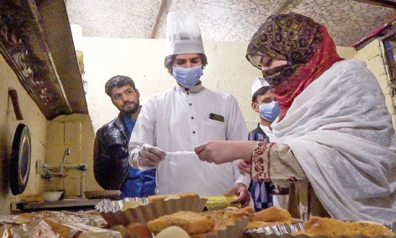 NoorA Ihsas works at her restaurant in Mingora. — Dawn