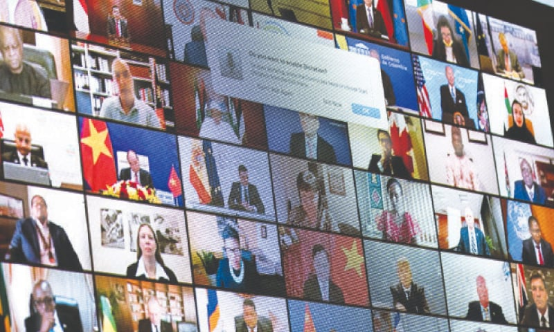 WORLD leaders are shown on a screen as President Joe Biden addresses the virtual climate summit on Friday.— AP