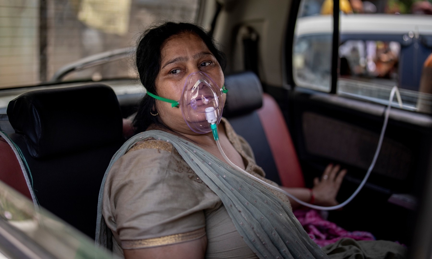 A Covid-19 patient sits inside a car and breathes with the help of oxygen provided by a Gurdwara, a Sikh house of worship, in New Delhi on April 24. — AP