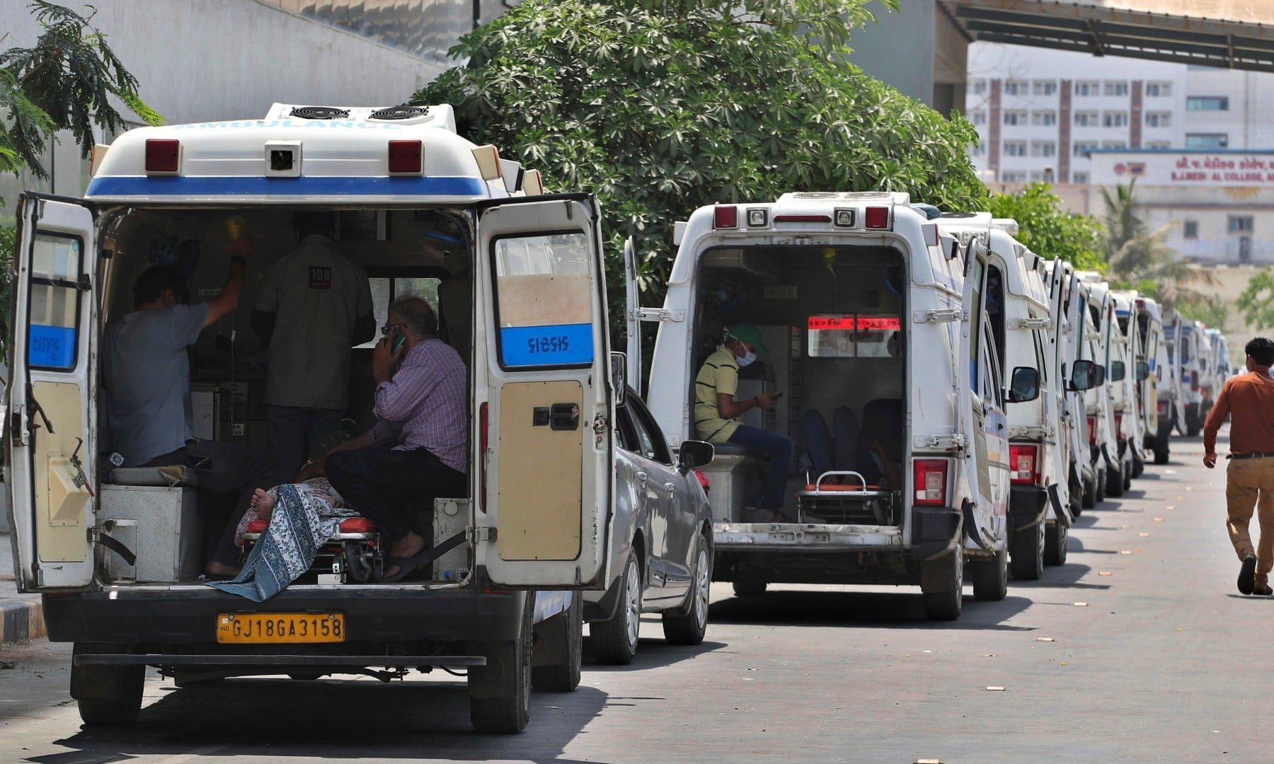 Ambulances carrying Covid-19 patients line up waiting for their turn to be attended to at a dedicated Covid-19 government hospital in Ahmedabad on April 22. — AP