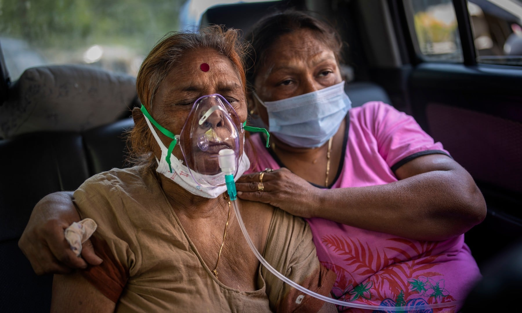 A Covid-19 patient receives oxygen inside a car provided by a Gurdwara, a Sikh house of worship, in New Delhi on April 24. — AP