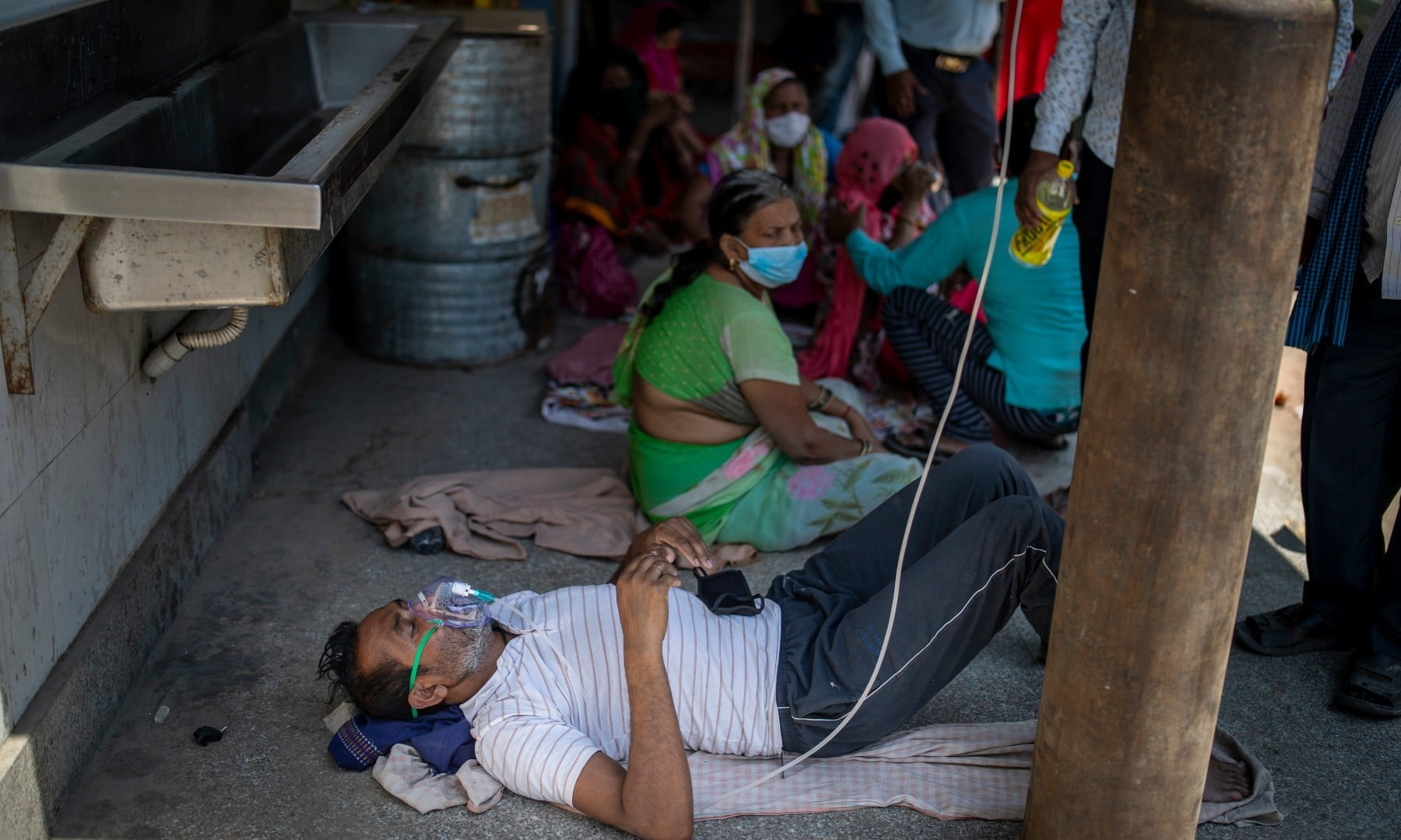 A patient receives oxygen outside a Gurdwara, a Sikh house of worship, in New Delhi on April 24. — AP