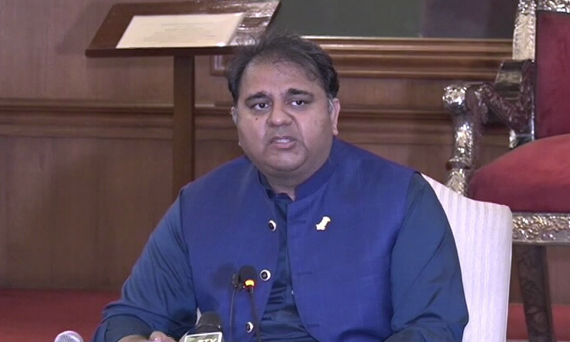 Minister for Information and Broadcasting Chaudhry Fawad Hussain addresses a press conference at the Governor House in Karachi. — DawnNewsTV