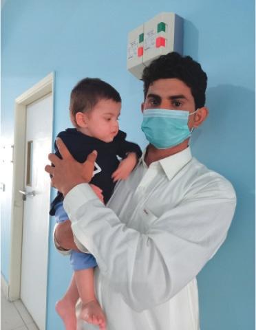 Baby Ghulam Nabi with father Amir Bakhsh in LRBT's Korangi Hospital, Karachi.—Photo by the writer