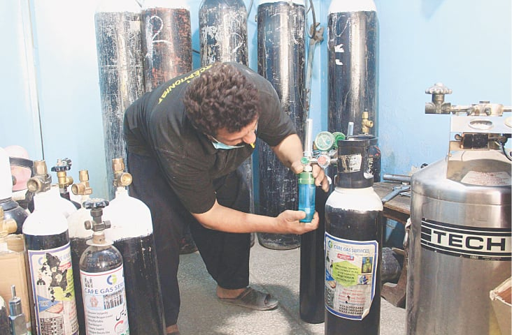 OXYGEN cylinders are being arranged at a private outlet in the city on Sunday amid an increase in demand caused by a sudden surge in coronavirus cases over the past week.—Online