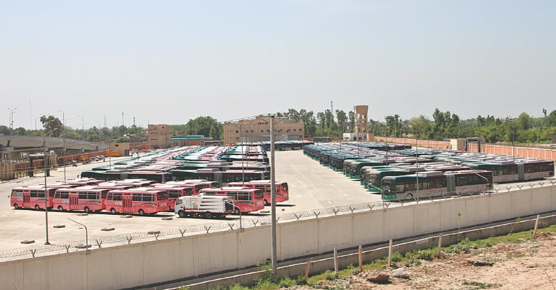 PESHAWAR: Buses are parked at Chamkani depot after the BRT service was temporarily closed on Sunday because of a surge in Covid-19 cases here.—Shahbaz Butt / White Star