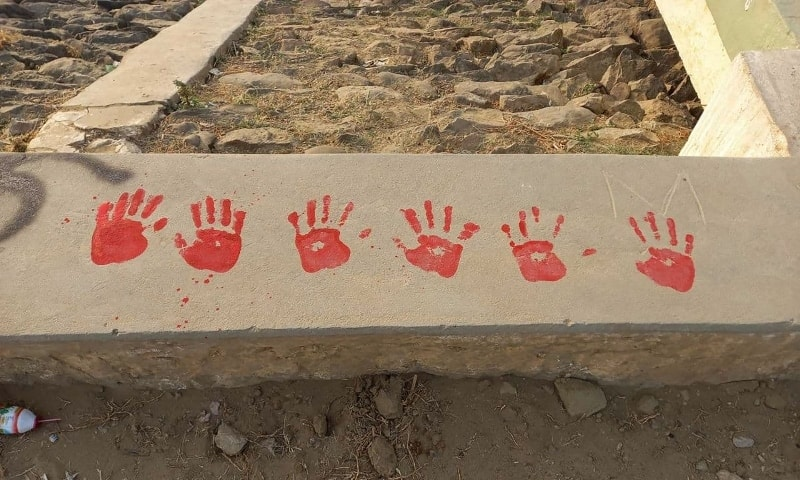 """This photo taken and received from an anonymous source via Facebook on April 25 shows protesters' red hand prints as they hold a """"red paint protest"""" as part of demonstrations against the military coup in Myingyan. — AFP"""
