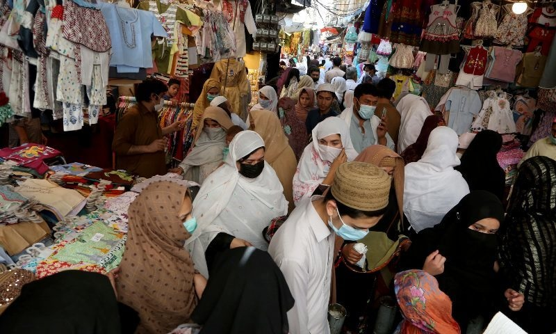 People ignore social distancing while shopping at a market after the government announced new restrictions to help control the spread of the coronavirus, in Peshawar, Monday, April 26, 2021. — AP