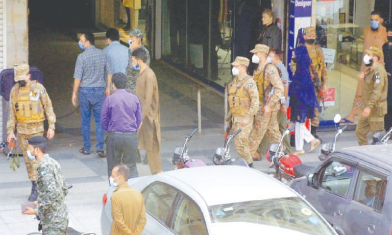 LAHORE: Security personnel patrolling a locality on Monday to implement new restrictions imposed due to a surge in coronavirus cases.—PPI