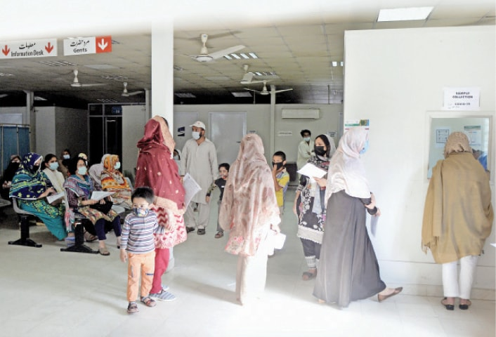 Women have brought their children to get them tested for Covid-19 at Pims in Islamabad on Monday. A number of coronavirus cases have been detected among children in the third wave. — White Star