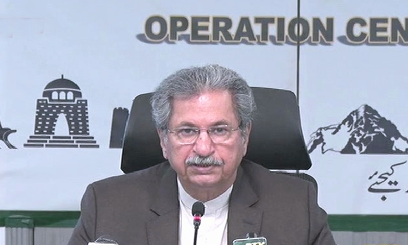 In this file photo, federal Minister for Education and Professional Training Shafqat Mahmood addresses a press conference. —  DawnNewsTV/File