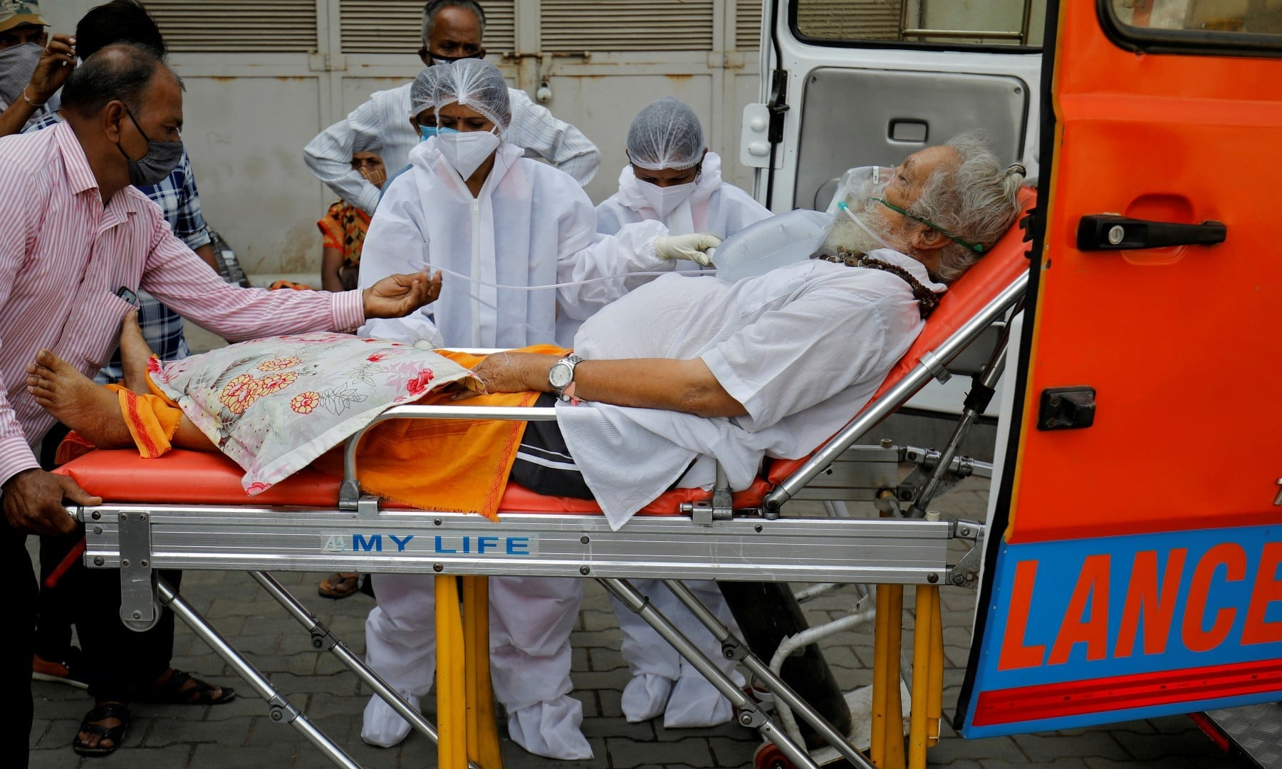 A patient wearing an oxygen mask is wheeled inside a Covid-19 hospital for treatment in Ahmedabad on April 26. —  Reuters