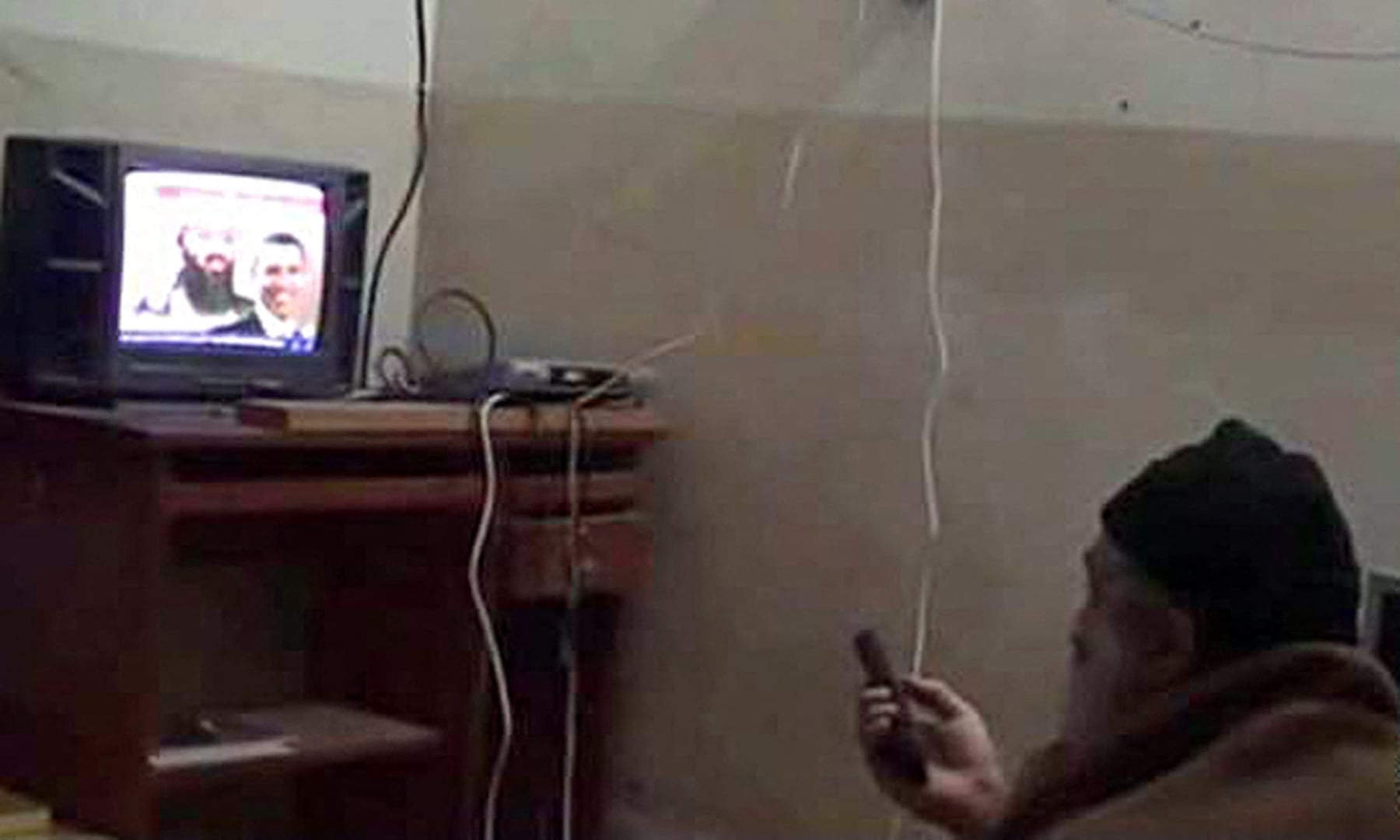 In this file photograph taken on May 7, 2011, a framegrab from an undated video released by the US Department of Defence on May 7, 2011, reportedly shows Al Qaeda leader Osama bin Laden watching himself and US president Barack Obama on television at his compound in Abbottabad. According to the Defence Department, the video was seized from the compound during a May 1 operation by US special forces in which Bin Laden was killed. — AFP/US DEPARTMENT OF DEFENCE