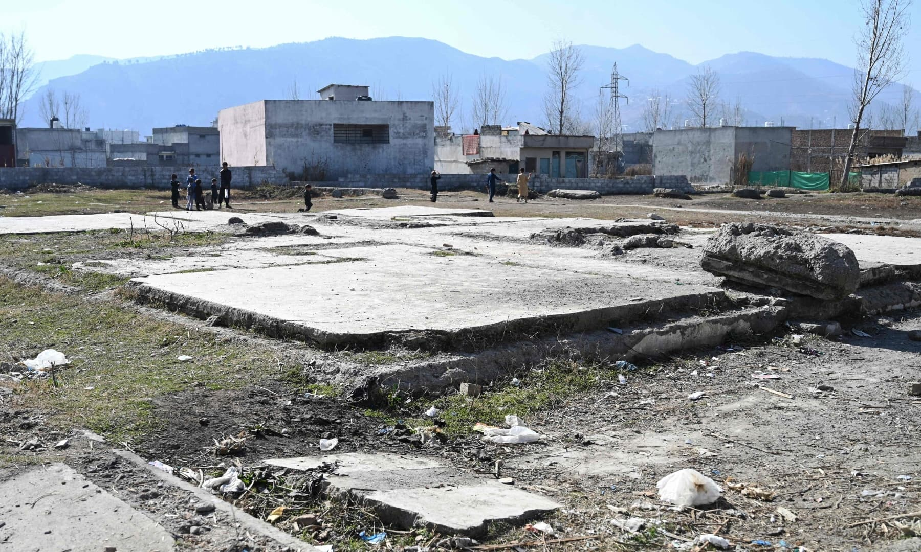 Children play cricket at the site of the demolished compound of slain former Al Qaeda leader Osama bin Laden in northern Abbottabad, In this picture taken on February 11, 2021. — AFP
