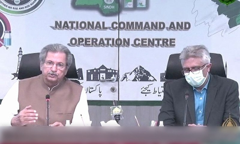 Federal education minister Shafqat Mahmood addresses a press conference alongside SAPM on Health Faisal Sultan on Tuesday. — DawnNewsTV