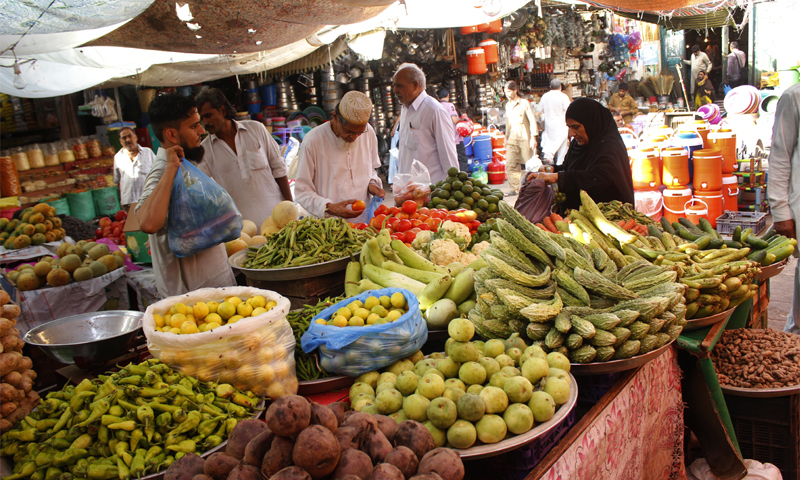 In this file photo, people buy vegetables from Karachi's Empress Market. — Photo by Shahab Nafees/File