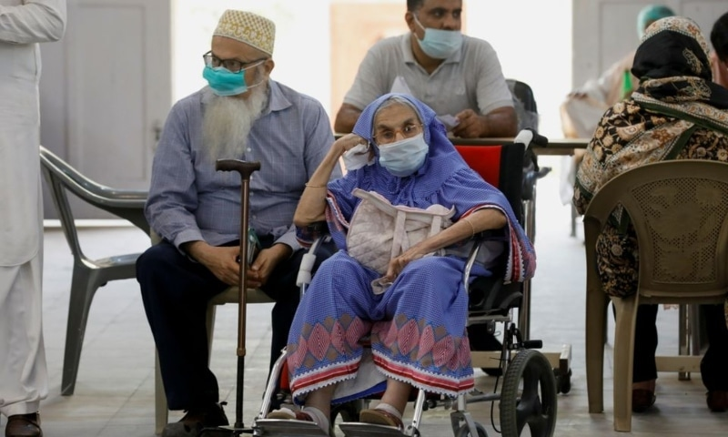 Residents wait for their coronavirus disease vaccine doses, at a vaccination centre in Karachi, April 2. — Reuters