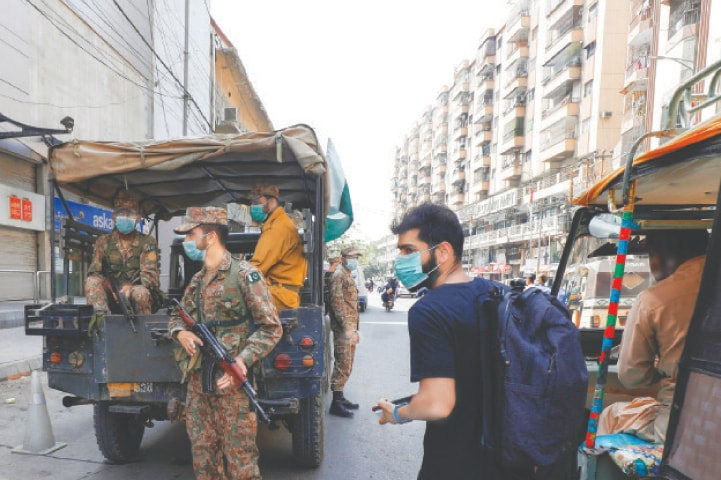 Army troops help enforce Covid-19 SOPs in the Saddar area on Wednesday.—Reuters