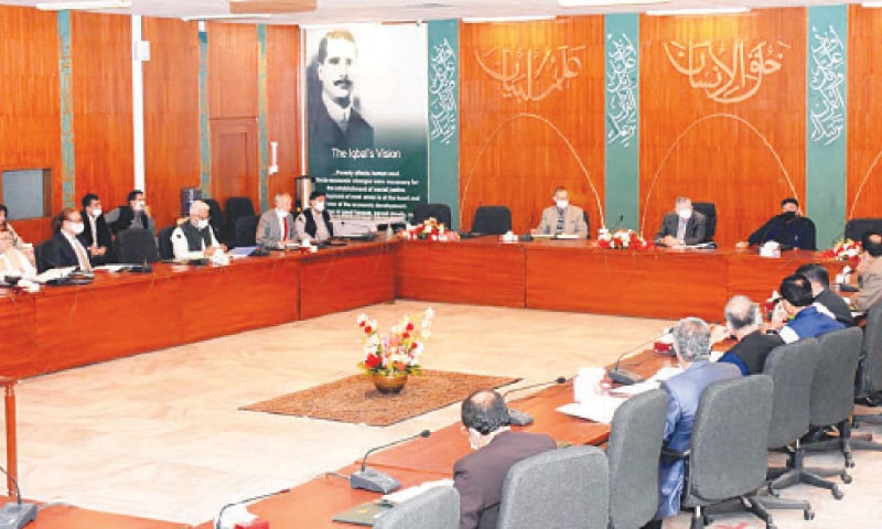 ISLAMABAD: Federal Minister for Finance and Revenue Shaukat Tarin chairing a meeting of the Economic Coordination Committee of the cabinet on Wednesday.—PPI