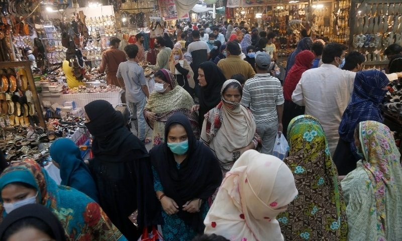 People ignore social distancing at a market in Lahore on April 28. - AP