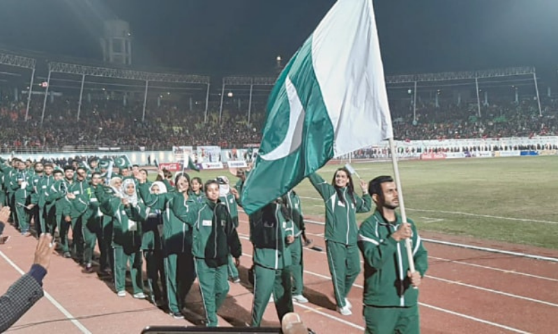 Pakistan's squash player Tayyab Aslam carries the national flag as he leads the country's contingent during the closing ceremony of the 13th South Asian Games in 2019. — File
