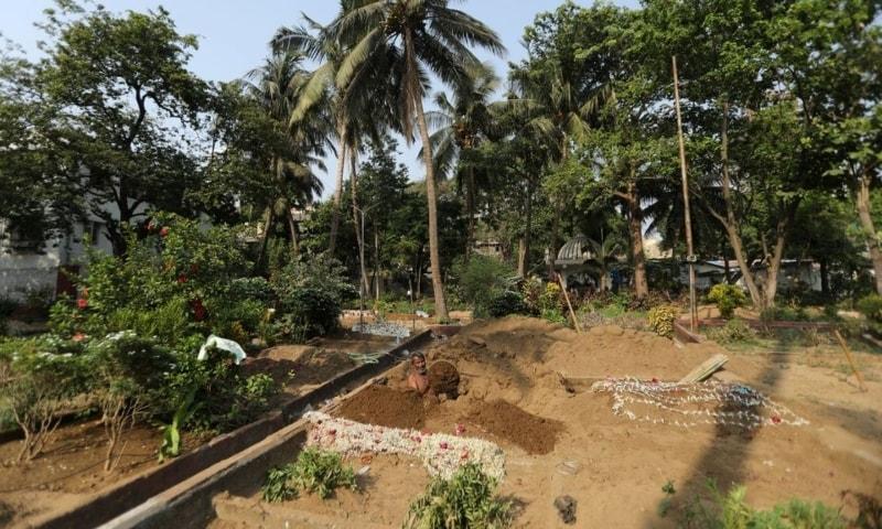 An assistant of Sayyed Munir Kamruddin, a gravedigger, prepares a grave for Covid-19 burials at a graveyard in Mumbai, India, April 28. — Reuters