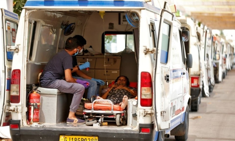 A woman with breathing problems waits inside an ambulance for her turn to enter a Covid-19 hospital for treatment, Ahmedabad, India, April 28. — Reuters