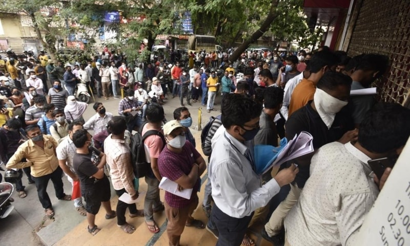 People wait in queues outside the office of the Chemists Association to demand necessary supply of the anti-viral drug remdesivir, in Pune, India, April 8. — AP