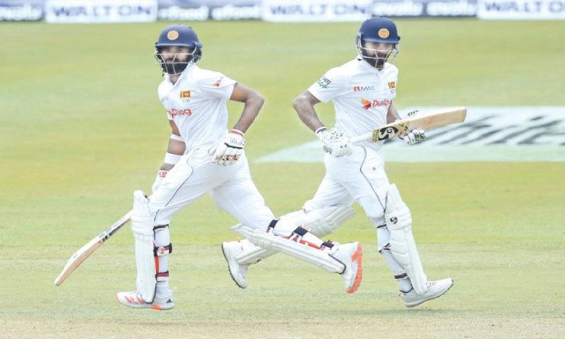 PALLEKELE: Sri Lankan opener Lahiru Thirimanne (L) and captain Dimuth Karunaratne take another  run during their 209-run partnership against Bangladesh at the Pallekele International Cricket Stadium on Thursday.—AP