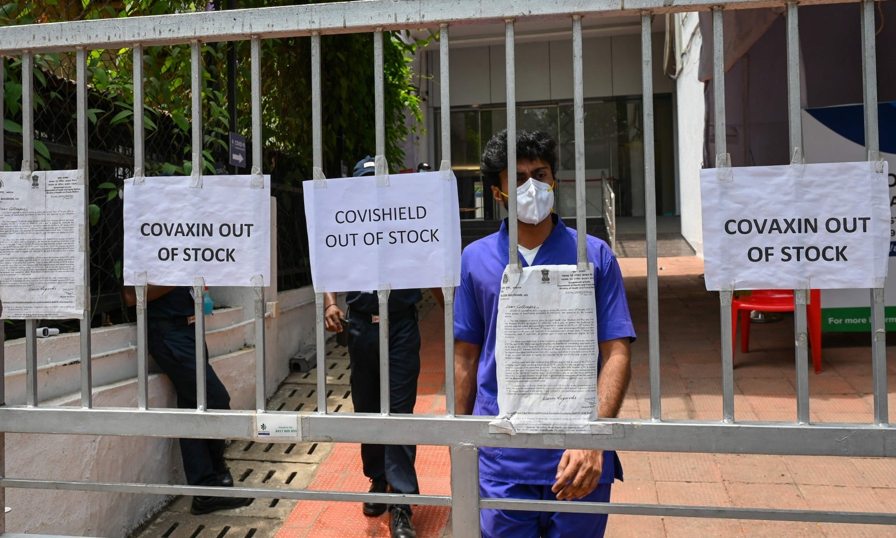 Signs announcing that vaccines are out of stock are seen at an entrance gate of a Covid-19 coronavirus vaccination centre closed for three days due to shortage of vaccine supplies, in Mumbai on April 30. — AFP