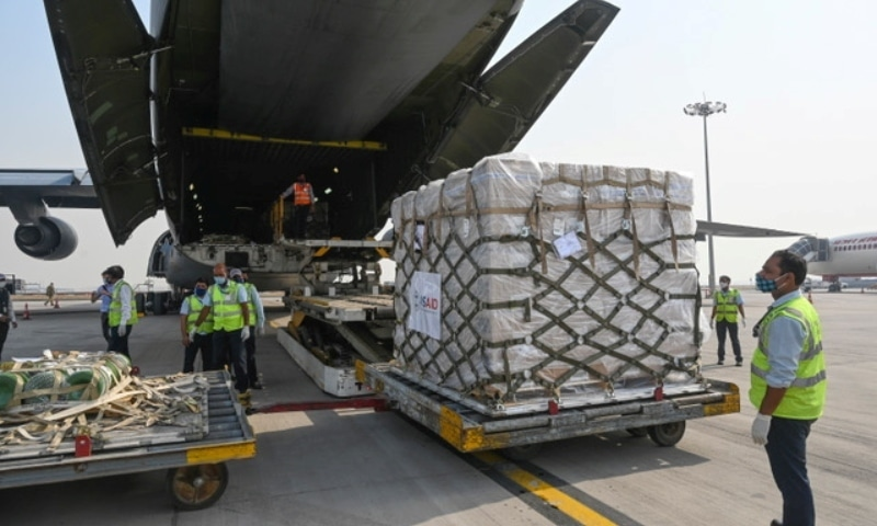 Ground staff unload coronavirus disease relief supplies from the United States at the Indira Gandhi International Airport cargo terminal in New Delhi on April 30. — Reuters