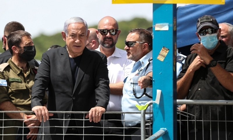 Israeli Prime Minister Benjamin Netanyahu, center left, visits Mount Meron, northern Israel, where fatalities were reported during Lag BaOmer festival on April 30. — AP
