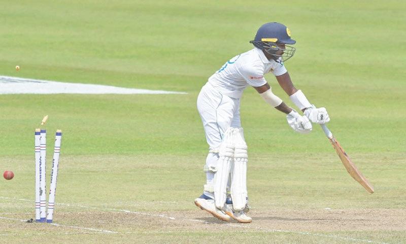 SRI LANKA'S Pathum Nissanka is bowled by Bangladesh seamer Taskin Ahmed during the second Test at the Pallekele International Cricket Stadium on Friday. — AFP