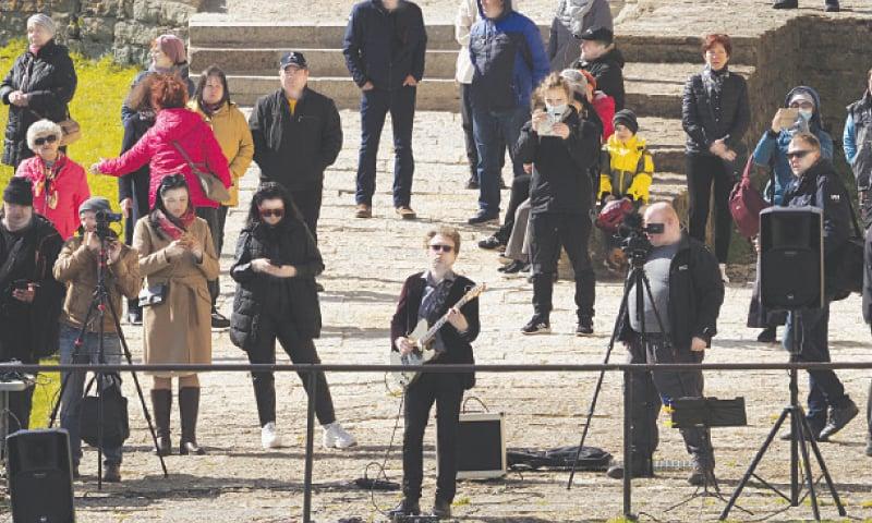Estonian guitarist Jaak Sooaar performs in a castle on the Russian-Estonian border during an unusual concert on Friday.—AP