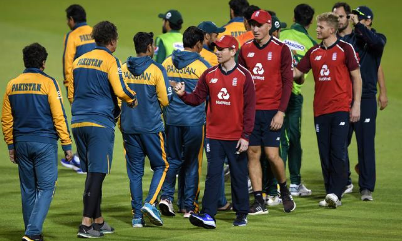 England's Eoin Morgan with Pakistan players after a T20I match. — Reuters/File