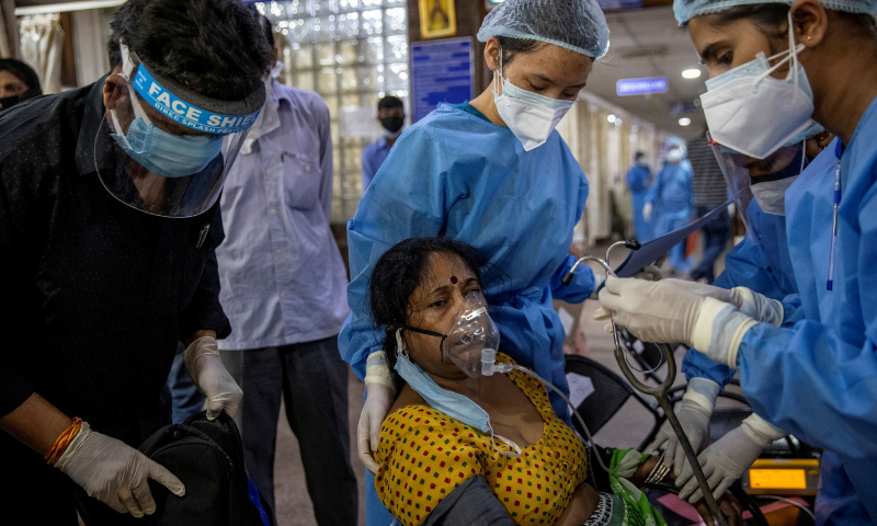 A patient suffering from the coronavirus receives treatment inside the emergency ward at Holy Family hospital in New Delhi, India. — Reuters