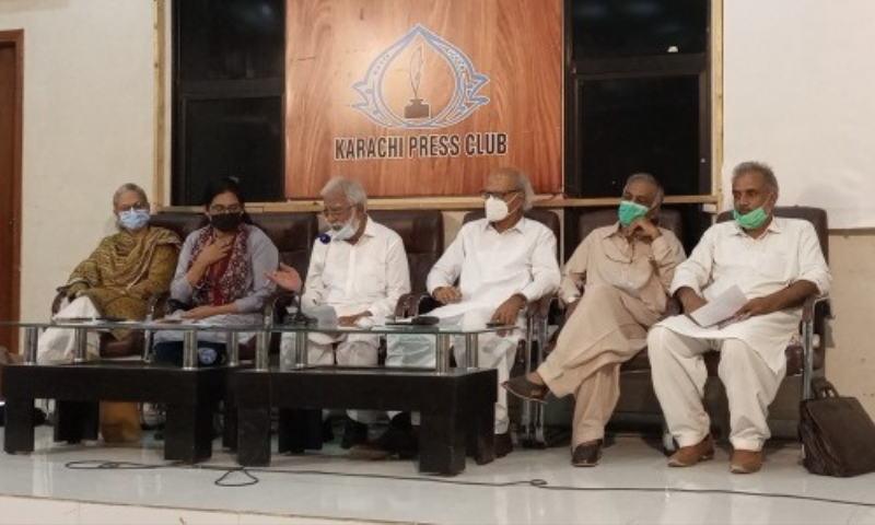 Labour leaders and trade unionists address the press conference at the Karachi Press Club on the eve of May Day. — Photo by writer