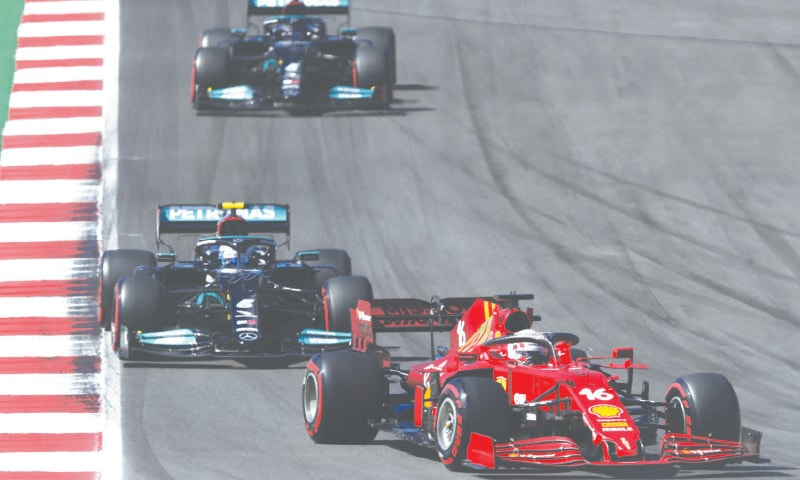 FERRARI'S Charles Leclerc takes a curve followed by Mercedes' pair of Valtteri Bottas (top) and Lewis Hamilton during the qualifying for the Portuguese F1 Grand Prix on Saturday.—AP